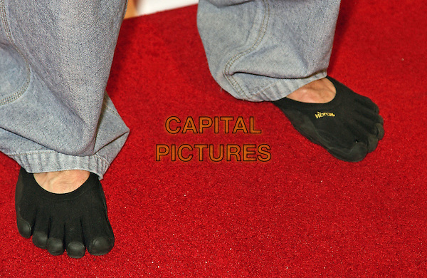 HUCK SEED's feet .6th Annual National Heads-Up Poker Championship Draw Party Red Carpet at Pure Nightclub inside Caesar's Palace Resort Hotel and Casino, Las Vegas, Nevada, USA, 4th March 2010..feet detail  black toes socks toes .CAP/ADM/MJT.© MJT/AdMedia/Capital Pictures.