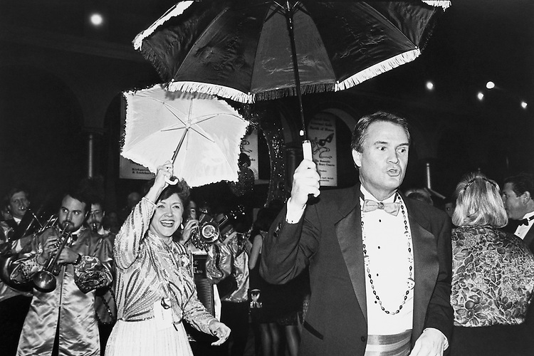 Rep. John Berlinger Breaux, D- La., with Mardi Gras Beads and his wife, Lois Daigle Breaux, dancing with umbrellas to a New Orleans jazz band at Gourmet Gala. March 8, 1993 (Photo by Laura Patterson/CQ Roll Call)