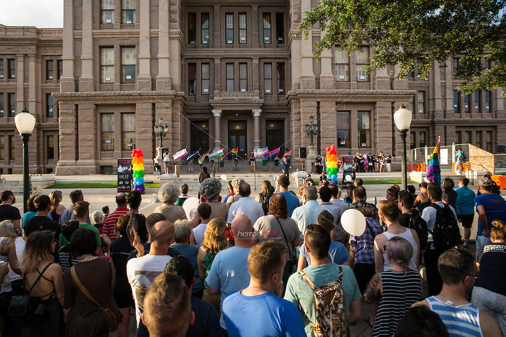 AUSTIN, TEXAS - Participants gather on the South steps of the Texas State Capitol on Saturday, Aug. 23, 2016 for the 5th Annual Stonewall Rally in observance of the 46th anniversary of the Stonewall Riots. The Stonewall Celebration pays tribute to the individuals that sparked the modern day gay rights movement in June 1969 at the Stonewall Inn. This event is sponsored by The Austin Gay & Lesbian Pride Foundation (AGLPF), Transgender Education Network of Texas, and Equality Texas.<br /> <br /> Use of this image in advertising or for promotional purposes is prohibited.<br /> <br /> Editorial Credit: Dan Herron / Herronstock Editorial.