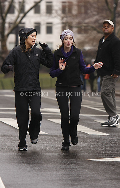 WWW.ACEPIXS.COM . . . . . ....March 31 2008, New York City....Actors Kate Hudson and Anne Hathaway were out in the rain in Manhattan's Central Park to film a jogging scene for the new movie 'Bride Wars'.....Please byline: AJ SOKALNER - ACEPIXS.COM.. . . . . . ..Ace Pictures, Inc:  ..(646) 769 0430..e-mail: info@acepixs.com..web: http://www.acepixs.com