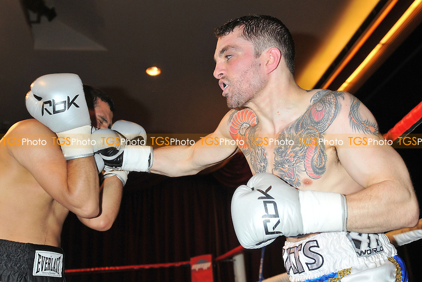 Andrew Gatenby (blue shorts) defeats Qasim Hussain in a Featherweight boxing contest at the Civic Hall, Grays, Essex, promoted by Carl Greaves - 15/03/14 - MANDATORY CREDIT: Philip Sharkey/TGSPHOTO - Self billing applies where appropriate - 0845 094 6026 - contact@tgsphoto.co.uk - NO UNPAID USE