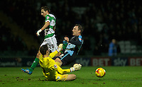 Chris Weale of Yeovil Town saves from Garry Thompson of Wycombe Wanderers during the Sky Bet League 2 match between Yeovil Town and Wycombe Wanderers at Huish Park, Yeovil, England on 24 November 2015. Photo by Andy Rowland.