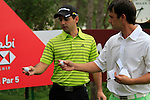 Rafa Echenique and Fabrizio Zanotti compare balls as they wait to tee off on the 10th tee to start his round during Thusday Day 1 of the Abu Dhabi HSBC Golf Championship, 20th January 2011..(Picture Eoin Clarke/www.golffile.ie)