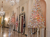 """The 2016 White House Christmas decorations are previewed for the press at the White House in Washington, DC on Tuesday, November 29, 2016. Pictured are Christmas decorations in the Grand Foyer looking towards the East Room. The first lady's office released the following statement to describe those decorations, """"This year's holiday theme, 'The Gift of the Holidays,' reflects on not only the joy of giving and receiving, but also the true gifts of life, such as service, friends and family, education, and good health, as we celebrate the holiday season.""""<br /> Credit: Ron Sachs / CNP"""