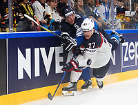 American Anders Lee (R) and Finland's Lasse Kukkonen fight for the puck during the Ice Hockey World Championship quarter-final match between the US and Finland in the Lanxess Arena in Cologne, Germany, 18 May 2017. Photo: Marius Becker/dpa /MediaPunch ***FOR USA ONLY***