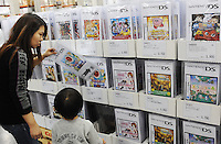 A mother and her son look at DS Nintendo at a Costco outlet, Tokyo, Japan. Costco has seen a surge in customers, who are able to buy in bulk at wholesale prices, as the economy has taken a down-turn..