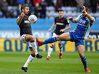 Bolton Wanderers' Gary O'Neil competing with Wigan Athletic's Sam Morsy <br /> <br /> Photographer Andrew Kearns/CameraSport<br /> <br /> The EFL Sky Bet Championship - Wigan Athletic v Bolton Wanderers - Saturday 16th March 2019 - DW Stadium - Wigan<br /> <br /> World Copyright &copy; 2019 CameraSport. All rights reserved. 43 Linden Ave. Countesthorpe. Leicester. England. LE8 5PG - Tel: +44 (0) 116 277 4147 - admin@camerasport.com - www.camerasport.com