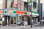 Sunkus and FamilyMart signboards on display at the entrance of their convenience stores on August 18, 2015, Tokyo, Japan. FamilyMart which is the nation's third-largest convenience store chain is expected to announce that it will acquire a smaller Nagoya-based operator ''Cocostore Corp.'' and its  657 stores. FamilyMart is also expected to integrate operations with UNY Group Holdings Co., which operates the country's fourth largest chain Circle K Sunkus Co., in September 2016. This would see the new group running about 18,400 stores in Japan, 500 more than the largest rival Seven-Eleven. (Photo by Rodrigo Reyes Marin/AFLO)