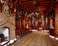 Two full suits of armour, one being tilt armour from 1580, stand proudly at one end of the impressive entrance hall to Sir Walter Scott's Scottish home