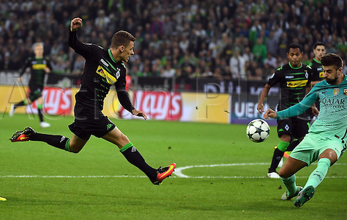 28.09.2016. Moenchengladbach, Germany. UEFA Champions league football. Borussia Moenchengladbach versus FC Barcelona.   Gerard Pique (Barcelona) gets his hand on the ball from Thorgan Hazard (Gladbach)
