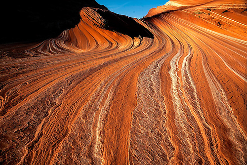Parallel lines appear in the eroded sandstone of Sand Cove at Coyote Buttes, Arizona