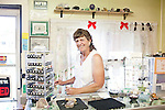 Ava Cole, nine-year owner of Ava's Silver and Rock Shop, rings up a customer  in Thermopolis, Wyoming August 21, 2011.