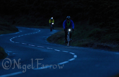 10 JUN 2011 - BRANSGORE, GBR - As the light fails Chris Edgley continues making his way around the bike course during the Triple Enduroman race at the Enduroman Ultra Triathlon Championships (PHOTO (C) NIGEL FARROW)