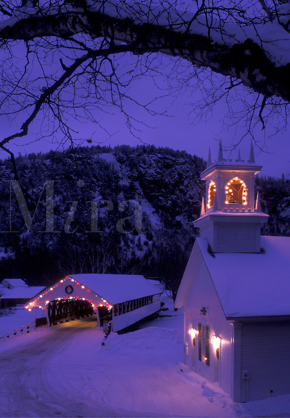 church, covered bridge, NH, New Hampshire, Stark, Christmas lights decorate the Stark Union Church and covered bridge in the evening in winter.