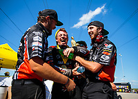 Jun 3, 2018; Joliet, IL, USA; NHRA top fuel driver Clay Millican (center) celebrates with his crew after winning the Route 66 Nationals at Route 66 Raceway. Mandatory Credit: Mark J. Rebilas-USA TODAY Sports