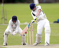 Joe Burke bats for North London during the Middlesex County Cricket League Division Three game between Highgate and North London at Park Road, Crouch End on Sat July 12, 2014
