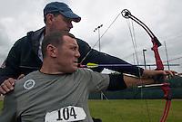 101005-N-7981E-781 SAN DIEGO (October 5, 2010)- Former Army Spc. Erik Hjeltnes learns to draw and fire a bow with his teeth from retired Army Cpl. Kevin Stone, a 2004 and 2008 Team U.S.A. Paralympic Gold Medal Winner and current world record holder, during the U.S. Olympic Committee's Paralympic Military Sports Camp hosted at Naval Medical Center San Diego. More than 60 injured service men and women from the U.S., British, and Israeli armed forces participated in the four-day event designed to introduce paralympic sport to active duty military personnel and veterans with physical injuries.  (U.S. Navy photo by Mass Communication Specialist 2nd Class James R. Evans / RELEASED)