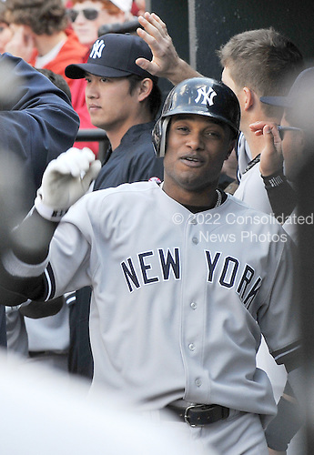 Baltimore, MD - April 9, 2009 -- New York Yankee second baseman  Robinson Cano (24) celebrates his 7th inning home run against the Baltimore Orioles at Oriole Park at Camden Yards in Baltimore, MD on Thursday, April 9, 2009.  The Yankees won the game 11 - 2..Credit: Ron Sachs / CNP.(RESTRICTION: NO New York or New Jersey Newspapers or newspapers within a 75 mile radius of New York City)