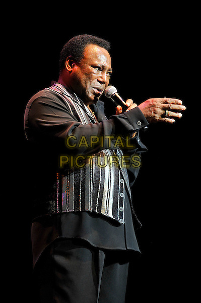 George Benson performing live in concert, Royal Albert Hall, Kensington, London, England. .28th June 2012.on stage in concert live gig performance music half length black shirt singing profile hand arm grey gray stripe    .CAP/MAR.© Martin Harris/Capital Pictures.