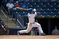 Jake Smolinski (7) of the Durham Bulls follows through on his swing against the Columbus Clippers at Durham Bulls Athletic Park on June 1, 2019 in Durham, North Carolina. The Bulls defeated the Clippers 11-5 in game one of a doubleheader. (Brian Westerholt/Four Seam Images)