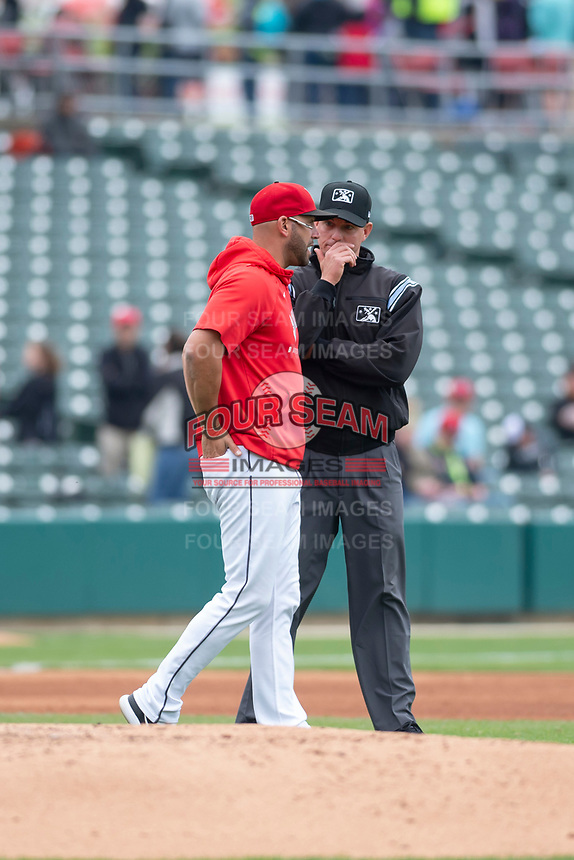 Umpire Shane Livensparger discusses a call with Indianapolis Indians manager Brian Esposito (5) during an Eastern League game between the Indians and Columbus Clippers on April 30, 2019 at Victory Field in Indianapolis, Indiana. Columbus defeated Indianapolis 7-6. (Zachary Lucy/Four Seam Images)