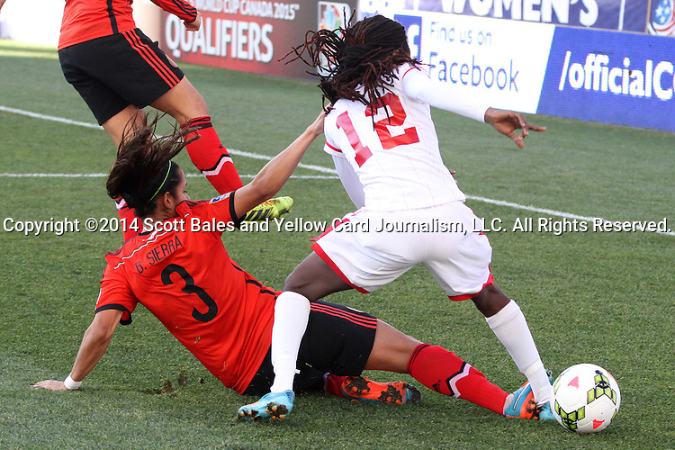 26 October 2014: Bianca Sierra (MEX) (3) slide tackles through the ankle of Ahkeela Mollon (TRI) (12). The Trinidad & Tobago Women's National Team played the Mexico Women's National Team at PPL Park in Chester, Pennsylvania in the 2014 CONCACAF Women's Championship Third Place game. Mexico won the game 4-2 after extra time. With the win, Mexico qualified for next year's Women's World Cup in Canada and Trinidad & Tobago face playoff for spot against Ecuador.