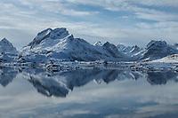 Winter reflection of mountains of Moskenesøy in fjord, Lofoten Islands, Norway
