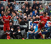 1st October 2017, St James Park, Newcastle upon Tyne, England; EPL Premier League football, Newcastle United versus Liverpool; Joe Gomez of Liverpool lobs the ball forward past Mikel Merino of Newcastle United in the 1-1 draw