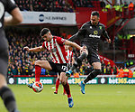 John Egan of Sheffield Utd and Josip Drmic of Norwich City during the Premier League match at Bramall Lane, Sheffield. Picture date: 7th March 2020. Picture credit should read: Simon Bellis/Sportimage