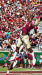 Florida State wide receiver Auden Tate goes high over Delaware State for a catch in the endzone in the first half of an NCAA football game in Tallahassee, Fl.  Florida State defeated Delaware State 77-6.