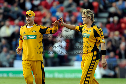 Scotland V Australia ODI at Grange CC, Edinburgh - a salute from Australian capt Michael Clarke for his most effective bowler, Shane Watson, 3 for 29 off 6 overs - Picture by Donald MacLeod 28.08.09