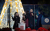 United States President Barack Obama and daughters Malia and Sasha, mother-in-law Marian Robinson,first lady Michelle Obama and actress Reese Witherspoon look on from the stage during the national Christmas tree lighting ceremony on the Ellipse south of the White House December 3, 2015 in Washington, DC. The lighting of the tree is an annual tradition attended by the President and the first family.<br /> Credit: Olivier Douliery / Pool via CNP
