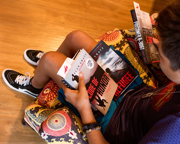 July 26, 2017. Raleigh, North Carolina.<br /> <br /> Noah deVries checks out several of Alan Gratz's books before the signing event begins. Noah and his mom drove from Greensboro to be at the event. <br /> <br /> Author Alan Gratz spoke about and signed his new book &quot;Refugee&quot; at Quail Ridge Books. The young adult fiction novel contrasts the stories of three refugees from different time periods, a Jewish boy in 1930's Germany , a Cuban girl in 1994 and a Syrian boy in 2015.