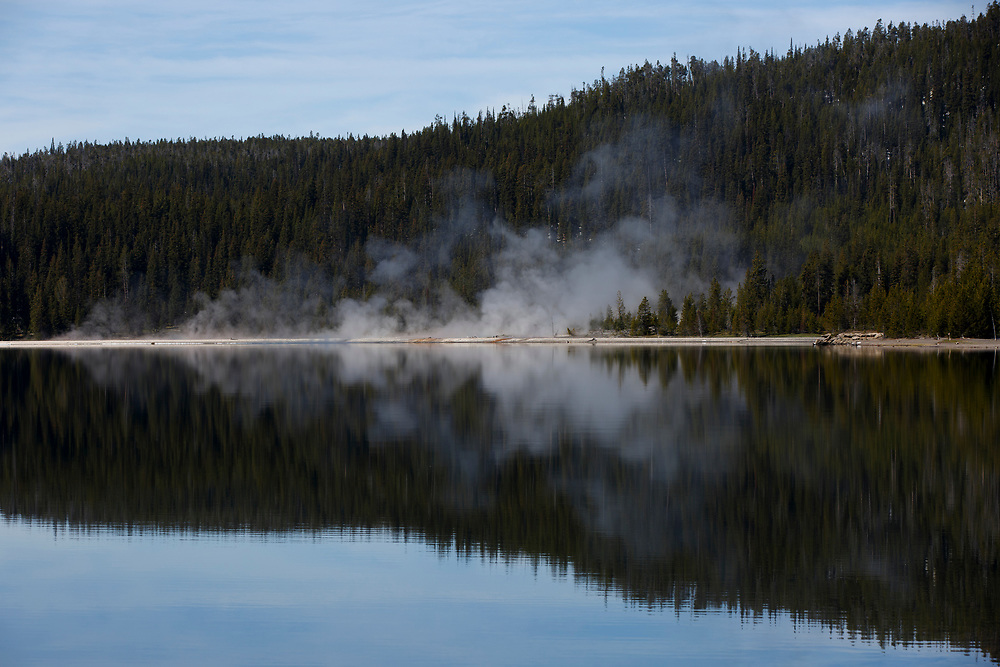 Steam rises from a geothermal feature along the shore of Yellowstone Lake in Yellowstone National Park, Wyoming on Tuesday, May 23, 2017. (Photo by James Brosher)