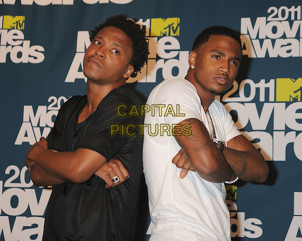 Lupe Fiasco, Trey Songz.in the Press Room at the 2011 MTV Movie Awards at Universal Studios' Gibson Amphitheatre in Universal City, California, USA, June 5th 2011.  .pressroom half length hand salute white t-shirt jeans  .CAP/ROT/TM.©TM/Roth Stock/Capital Pictures