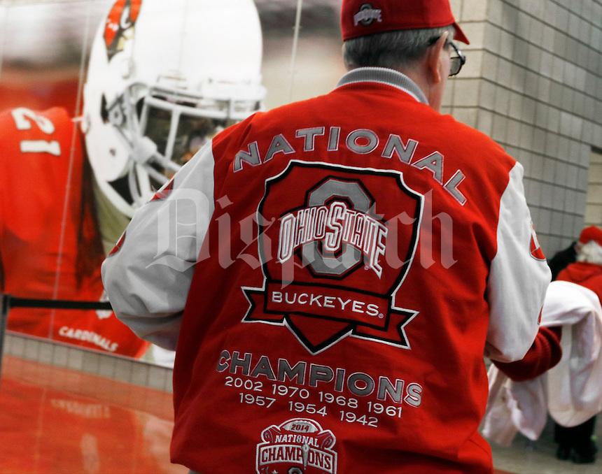 An Ohio State fan wears a jacket commemorating previous National Championship appearances prior to the College Football Playoff semifinal Fiesta Bowl against the Clemson Tigers at University of Phoenix Stadium in Glendale, Arizona on Dec. 31, 2016. (Barbara J. Perenic/The Columbus Dispatch)