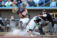 Quad Cities River Bandits catcher Roberto Pena #10 looks to tag Tyrone Taylor #13 sliding in safely as umpire Charlie Ramos looks to make the call during a game against the Wisconsin Timber Rattlers on May 24, 2013 at Modern Woodmen Park in Davenport, Iowa.  Quad Cities defeated Wisconsin 4-3  (Mike Janes/Four Seam Images)