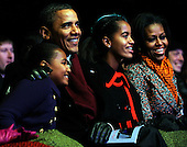 United States President Barack Obama and the First Family participate in the 2011 National Christmas Tree Lighting on the Ellipse in Washington, DC, on Thursday, December 1, 2011. From left are Sasha Obama; The President;  Malia Obama; and first lady Michelle Obama.    .Credit: Roger L. Wollenberg / Pool via CNP