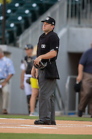 Home plate umpire Clint Fagan prior to the International League game between the Rochester Red Wings and the Charlotte Knights at BB&T BallPark on August 8, 2015 in Charlotte, North Carolina.  The Red Wings defeated the Knights 3-0.  (Brian Westerholt/Four Seam Images)