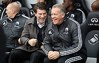 Wednesday 09 February 2013<br /> Pictured L-R: Swansea manager Michael Laudrup sharing a joke with Alan Curtis <br /> Re: Barclay's Premier League, Swansea City FC v Queen's Park Rangers at the Liberty Stadium, south Wales.