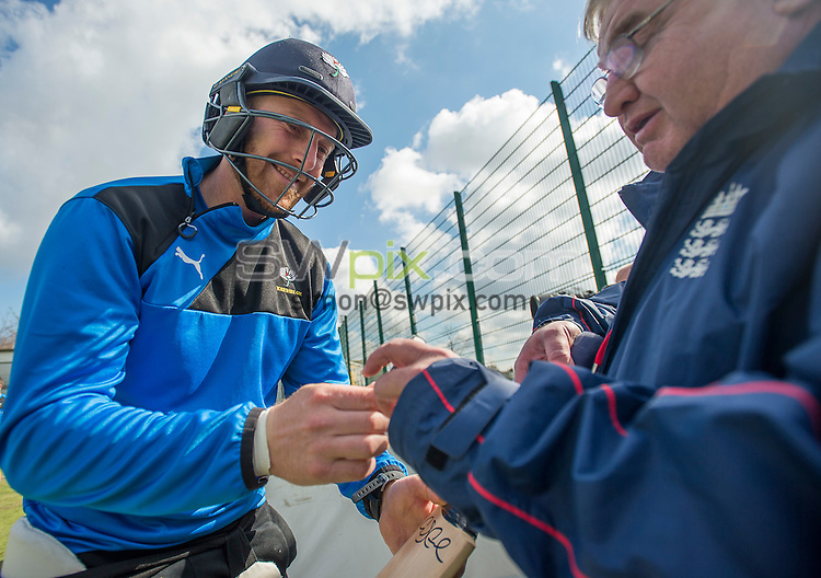 Picture By Allan McKenzie/SWpix.com - 08/04/16 - Cricket - Yorkshire CCC Training - Yorkshire County Cricket Club - Headingley, Leeds, England - Andrew Gale autographs bats for fans during net practice.