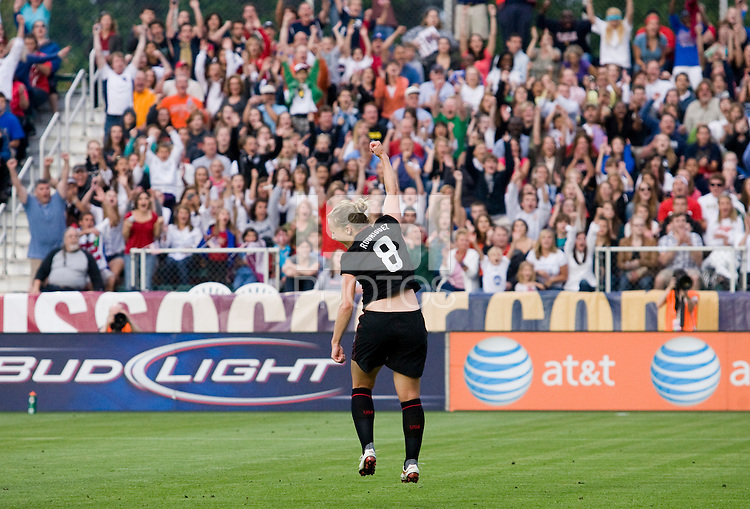 Amy Rodriguez (8) of the USWNT celebrates her goal in front of the crowd during the game at WakeMed Soccer Park in Cary, NC.   The USWNT defeated Japan, 2-0..