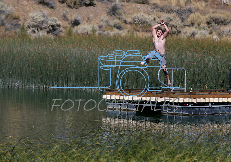 Half marathon runner Jay Gilbert jumps in the lake after completing the 8th annual Take it to the Lake race at Cave Lake State Park, near Ely, Nev., on Saturday, Sept. 21, 2019.<br /> Photo by Cathleen Allison/Nevada Momentum