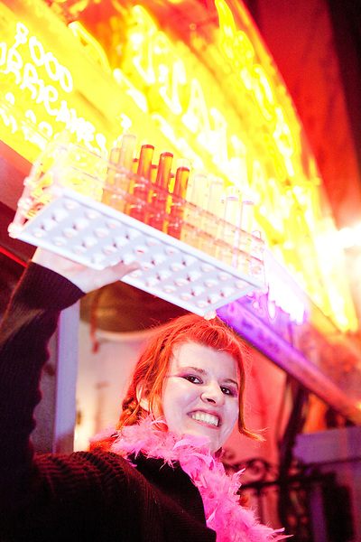 Jennifer Stanley sells shots of liquor in test tubes on Bourbon Street during Mardi Gras in New Orleans on February 15, 2010.