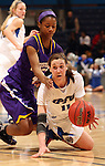 SIOUX FALLS, SD - MARCH 10:  Charnelle Reed #4 from Western Illinois reaches for the ball as  Amanda Hyde #11 from IPFW tips it to a teammate in the second half of their quarterfinal game Sunday afternoon at the 2013 Summit League Championships in Sioux Falls, SD.  (Photo by Dave Eggen/Inertia)