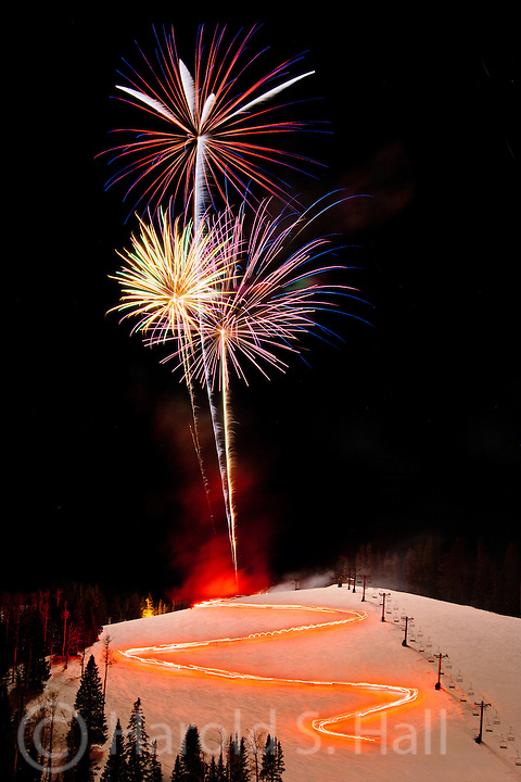 Ski Apache, located in Mescalero, New Mexico celebrates with fireworks and skiers carrying fire torches.