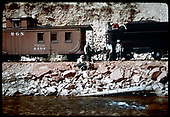 RGS #74 siphoning water from Dolores River near Stoner while dismantling the road.  Caboose #0404 has &quot;MB&amp;W&quot; just above the number.<br /> RGS  Stoner (near), CO  Taken by Pfeiffer, Jack A. - 9/16/1952
