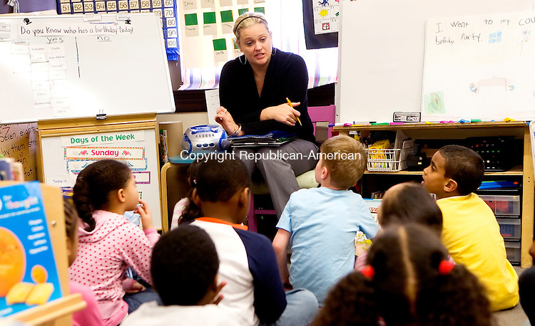 BOSTON, MA- 03 APR 07- 040307JT02- <br /> Kindergarten teacher Caitlin McArdle talks to her class at Samuel Mason Elementary School in Roxbury, Mass. on Tuesday, Apr. 3.<br /> Josalee Thrift Republican-American