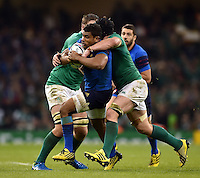 Wesley Fofana of France is tackled by Sean O'Brien of Ireland. Rugby World Cup Pool D match between France and Ireland on October 11, 2015 at the Millennium Stadium in Cardiff, Wales. Photo by: Patrick Khachfe / Onside Images
