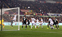 Pictured: Ashley Williams o Swansea (L) crosses the ball into the Everton box with a header. Tuesday 23 September 2014<br />